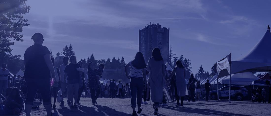 People walking outdoors at Surrey Fusion Festival in 2019.